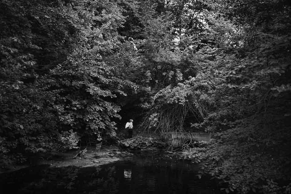 boy-wearing-angel-wings-by-a-river-pool