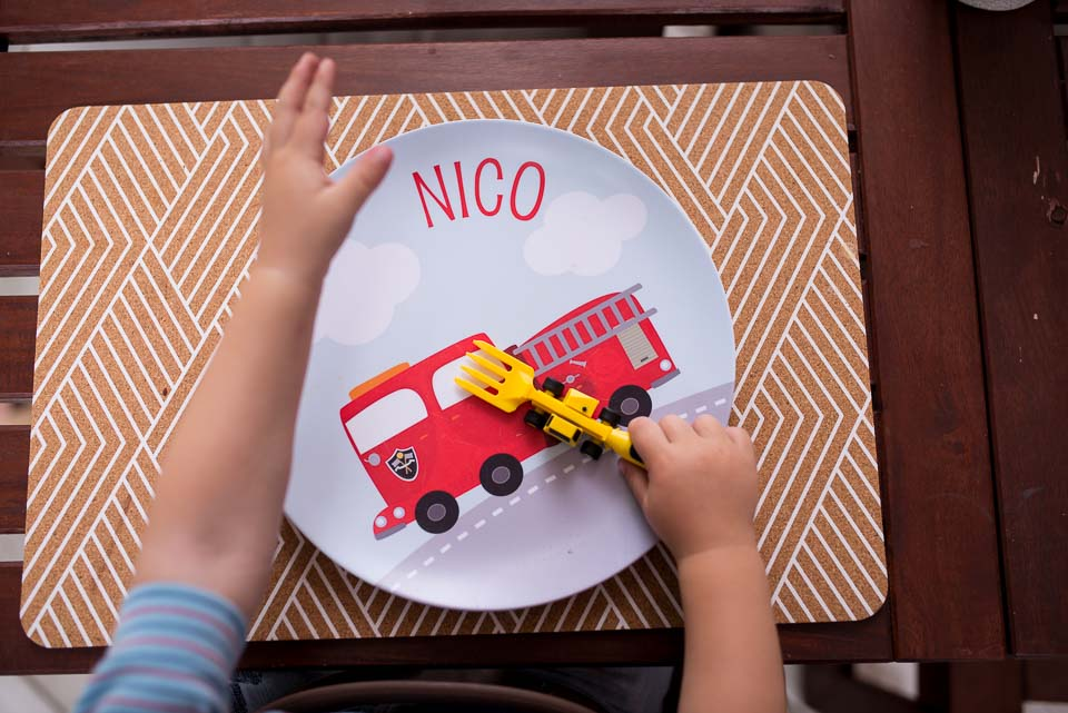 Documentary family photographer photographed boy waiting to eat from customized name dinner plate