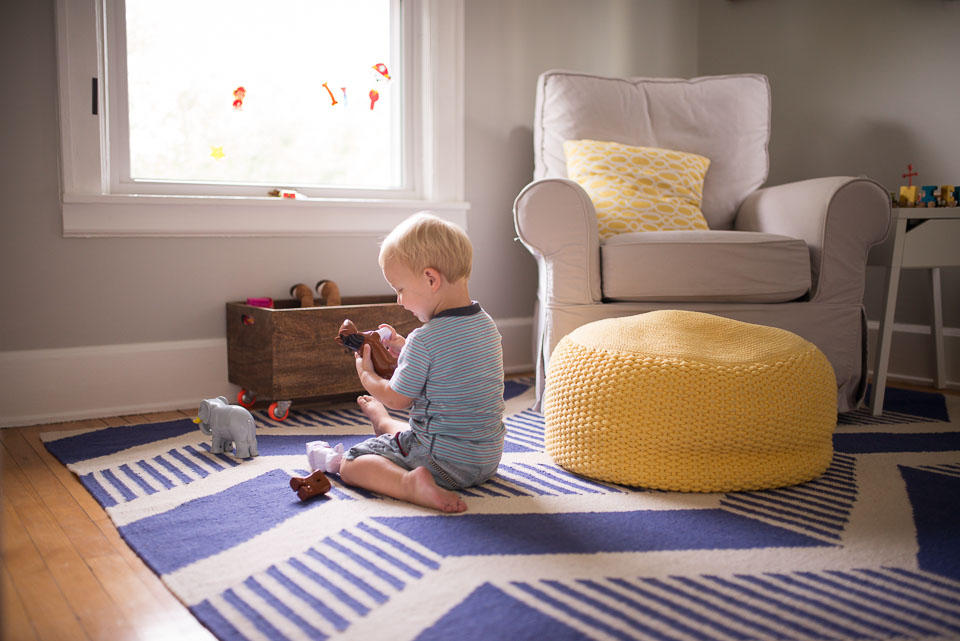 Documentary family photograph of a boy playing in his room