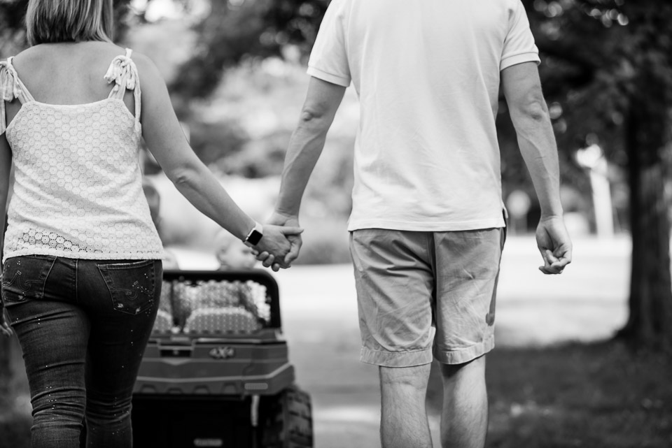 East Grand Rapids couple holds hands on a family walk during a documentary photo session