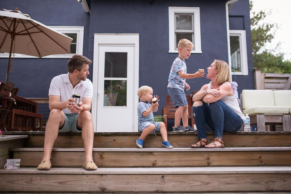 During a Grand Rapids documentary family photography session a boy shares his cupcake with his mother