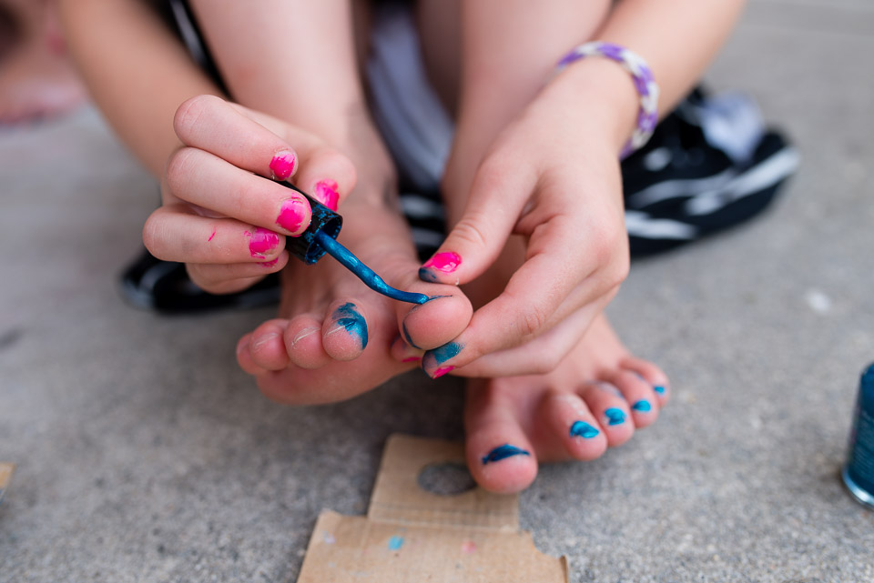 Close up documentary photography session image of young Grand Rapids girl painting her toenails