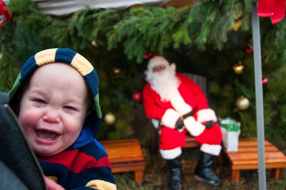 child-cries-near-santa