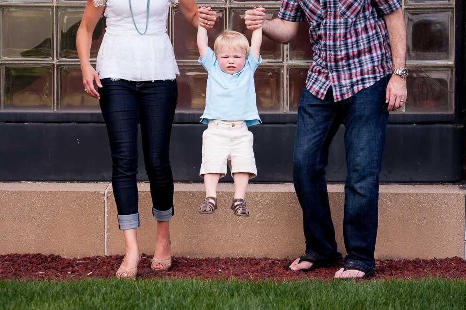 parents-pick-up-toddler-together