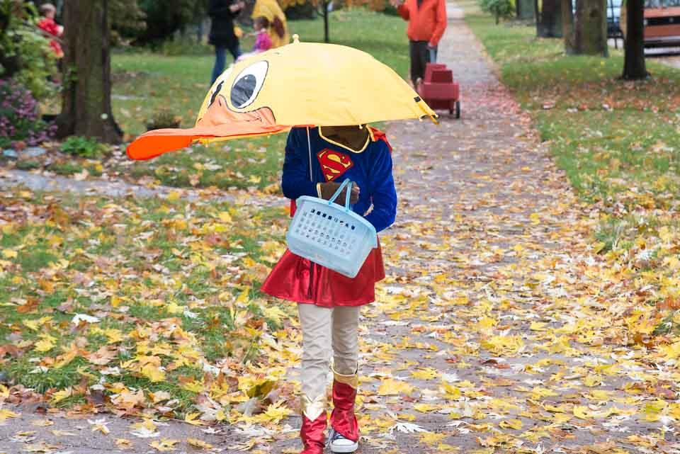 yellow-duck-umbrella-and-supergirl-costume